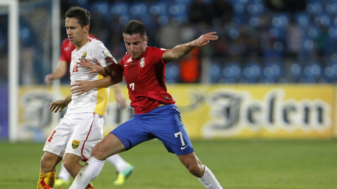 Serbia's Zoran Tosic, right challenges for the ball with Macedonia's Predrag Randelovic during their World Cup 2014 Group A qualifying soccer match at the City Stadium in Jagodina, Serbia, Tuesday, Oct. 15, 2013