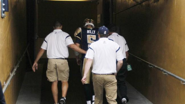 Winnipeg Blue Bombers quarterback Drew Willy (5) enters the tunnel after being injured during a sack by the Hamilton Tiger-Cats in first half of CFL action in Winnipeg on July 2, 2015. There's no doubt in head coach Mike O'Shea's mind who his starting quarterback will be Friday night. O'Shea told reporters Monday he expects incumbent Drew Willy under centre when the Bombers host the Montreal Alouettes. THE CANADIAN PRESS/John Woods
