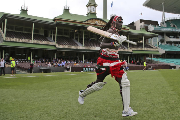 A member of the Maasai Cricket Warriors runs onto the field during a charity cricket match against former Rugby players in Sydney, Australia, Thursday, Feb. 4, 2016. The Maasai Cricket Warriors travel