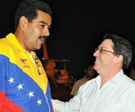 "Picture released by Cuban communist newspaper Granma, shows Venezuelan President Nicolas Maduro (L) being met by Cuban Foreign Minister Bruno Rodriguez at the Jose Marti airport in Havana on April 26, 2013. Maduro met with former Cuban president Fidel Castro Saturday during a visit to strengthen the ""strategic alliance"" between the two leftist nations"