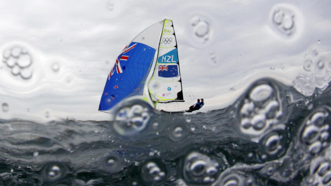 New Zealand's Peter Burling and Blair Tuke sail before the fifth race of the men's 49er sailing class at the London 2012 Olympic Games