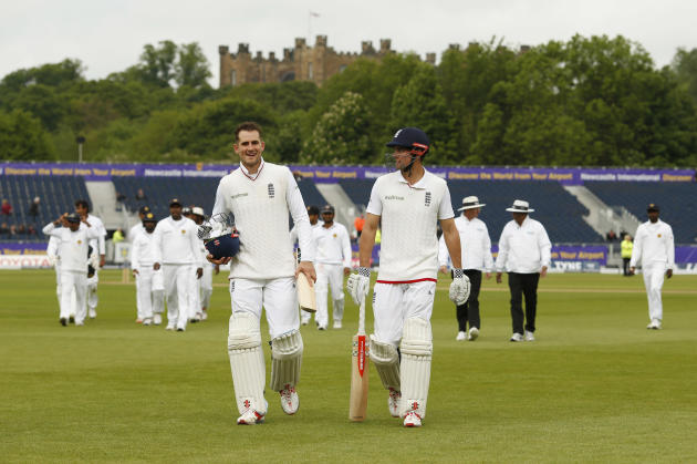 England's Alex Hales and Alastair Cook walk off at tea