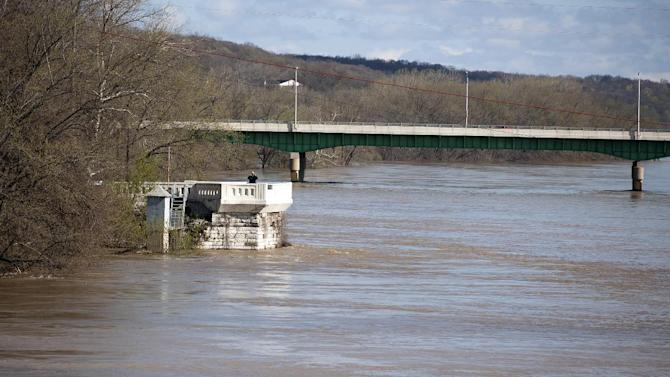 A person observes the flooding on the Wabash River from the Brown Street Overlook, in West Lafayette, Ind. on Saturday, April 20, 2013. (AP Photo/The Journal & Courier, Brent Drinkut) MANDATORY CREDIT; NO SALES