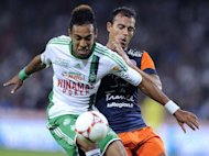 Saint-Etienne's Gabonese forward Pierre-Eme Aubameyang (L) vies with Montpellier's Brazilian defender Vitorino Hilton (R) during the French L1 football match Montpellier (MHSC) vs Saint Etienne (ASSE) at the Mosson stadium in Montpellier southern France on September 21