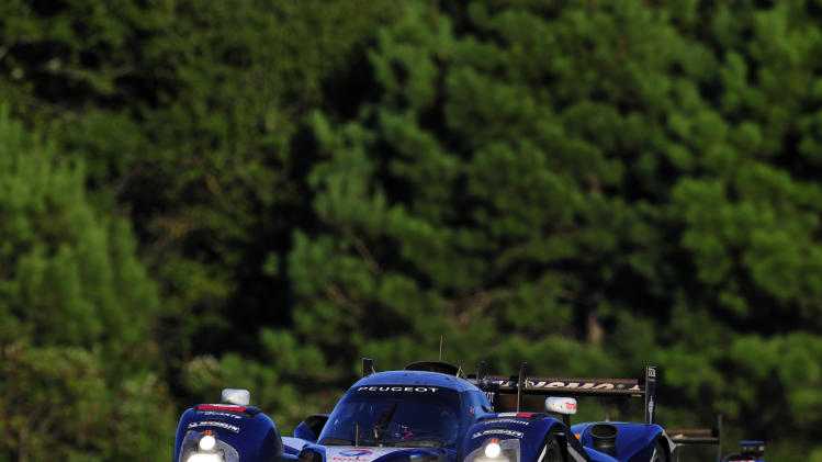 Peugeot driver Franck Montagny, of France, goes through a corner during the American Le Mans Series' Petit Le Mans auto race at Road Atlanta, Saturday, Oct. 1, 2011, in Braselton, Ga.  (AP Photo/Rainier Ehrhardt)