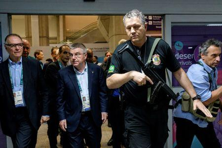 Thomas Bach, President of the International Olympic Committee, is escorted by police upon arrival in Rio de Janeiro