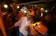 This file photo, taken in 2006, shows Filipino miners riding an elevator to the mine tunnel of Philex Mining Corp., in Padcal, northern Benguet province. A waste spillage at the mine has been contained after the slime threatened to contaminate one of the country's largest rivers, according to the government