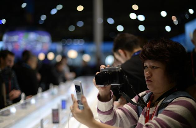 A person takes a picture of the new devices at the Mobile World Congress, the world's largest mobile phone trade show in Barcelona, Spain, Monday, March 2, 2015. (AP Photo/Manu Fernandez)