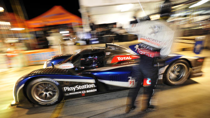 Peugeot driver Stephane Sarrazin, of France, leaves the pits after his last pit stop on his way to winning the American Le Mans Series' Petit Le Mans auto race at Road Atlanta, Saturday, Oct. 1, 2011, in Braselton, Ga. (AP Photo/Rainier Ehrhardt)