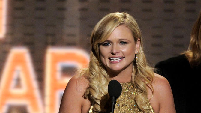 "Miranda Lambert accepts the award for album of the year for ""Four the Record"" at the 47th Annual Academy of Country Music Awards on Sunday, April 1, 2012 in Las Vegas. (AP Photo/Mark J. Terrill)"