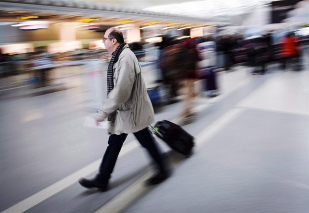 A man carries his luggage at Pearson International Airport in Toronto on December 20, 2013.
