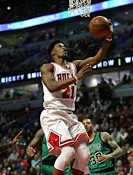 Jimmy Butler of the Chicago Bulls lays in a shot against the Boston Celtics, at the United Center in Chicago, Illinois, on February 16, 2017