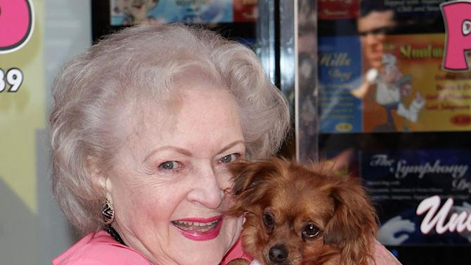 """Betty White unveils the """"Naked"""" hot dog at Pink Hot Dogs at Universal CityWalk on April 19, 2010 in Universal City, California."""