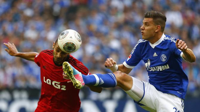 Szalai of Schalke 04 challenges Toprak of Bayer Leverkusen during their German first division Bundesliga soccer match in Gelsenkirchen