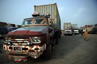 Container trucks carrying NATO supplies are parked at a terminal in Karachi. The first trucks supplying NATO troops in Afghanistan crossed the border from Pakistan after Islamabad ended a seven-month blockade
