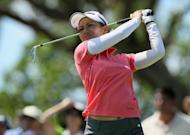 Ai Miyazato of Japan hits a tee shot on the 16th hole during the third round of the LPGA LOTTE Championship at the Ko Olina Golf Club, April 20, in Kapolei, Hawaii. Miyazato defied difficult, windy conditions to post a two-under 70 and take a three-shot lead