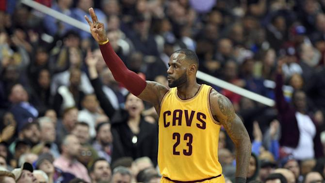 "FILE - In this Feb. 6, 2017, file photo, Cleveland Cavaliers forward LeBron James gestures after he scored a basket during the second half of an NBA basketball game against the Washington Wizards in Washington. The Cavaliers got back to championship form in February. The NBA champions went 9-2, a nice turnaround after going 7-8 in January, when James called the team's roster ""top heavy"" and asked for help. (AP Photo/Nick Wass, File)"