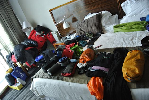 The team goes through their gear while in their hotel room in Punta Arenas.