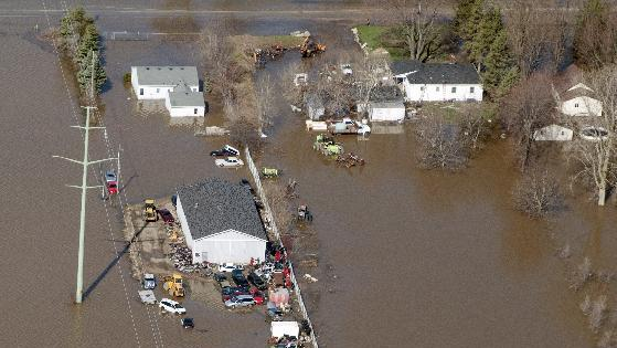 An automobile scrapyard in James Township on South Center near the Tittabawassee River is flooded on Monday, April 22, 2013. Area rivers overflowed their banks over the weekend after days of heavy rain saturated the ground. (AP Photo/Jeff Schrier, The Saginaw News)