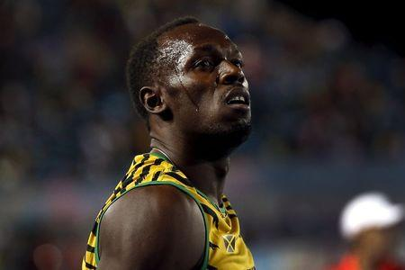 Usain Bolt of Jamaica reacts after Jamaica placed second behind the U.S. in the 4x100 meters race at the IAAF World Relays Championships in Nassau