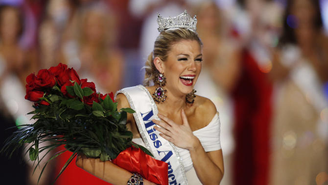 FILE - In this Jan. 12, 2013 file photo, Miss New York Mallory Hytes Hagan reacts as she is crowned Miss America 2013 in Las Vegas. Gov. Chris Christie's spokesman Michael Drewniak on Wednesday night, Feb. 13, 2013  confirmed news of the Miss America pageant's return to Atlantic City.  Lt. Gov. Kim Guadagno is scheduled make a formal announcement Thursday on Atlantic City's Boardwalk Hall. (AP Photo/Isaac Brekken, File)