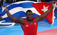 Mijain Lopez Nunan of Cuba celebrates after defeating Estonia's Heiki Nabi during their 120kg Greco Roman Wrestling Final match of the London 2012 Olympic Games at the Excel Centre in London on August 6, 2012. AFP PHOTO/ MANAN VATSYAYANA