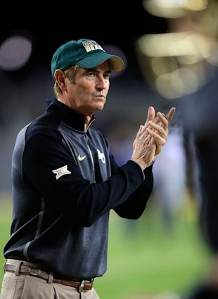 WACO, TX - DECEMBER 06:  Baylor Bears head coach Art Briles watches as his team goes through pregame drills for their game against the  Kansas State Wildcats on December 6, 2014  at McLane Stadium in Waco, Texas.  (Photo by Jamie Squire/Getty Images)