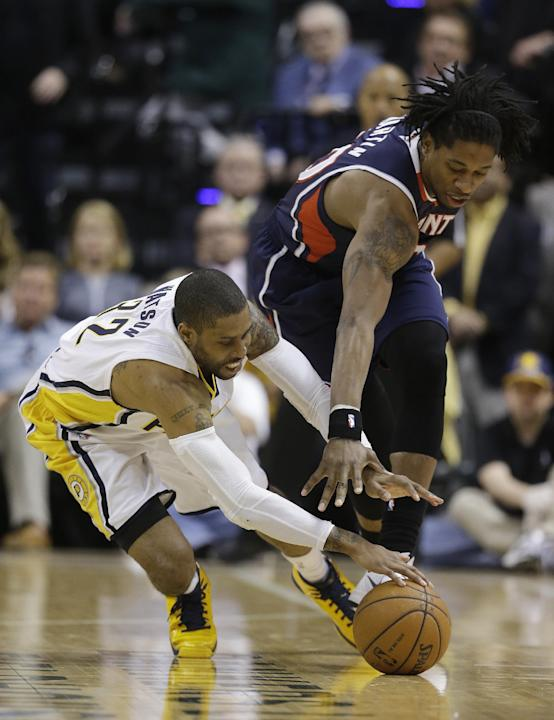 Indiana Pacers' C.J. Watson (32) and Atlanta Hawks' Cartier Martin (20) dive for a loose ball during the second half in Game 2 of an opening-round NBA basketball playoff series Tuesday, April