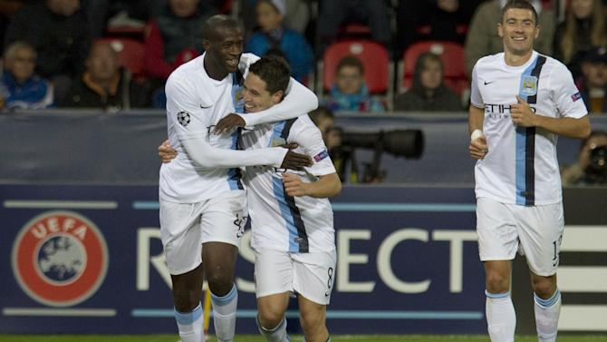 Manchester City's players, Yaya Toure, left, and Samir Nasri, second left, celebrate their second goal, during the Champion's League Group D soccer match against Viktoria Plzen , in Plzen, Czech Republic, Tuesday, Sept. 17, 2013. (AP Photo, CTK/Michal Kamaryt)