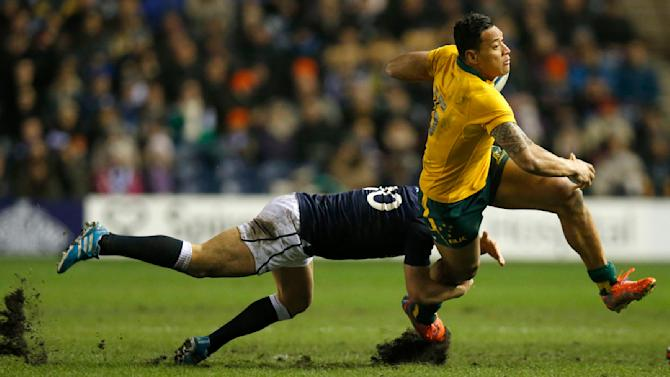 Australia's Israel Folau is tackled by Scotland's Duncan Weir during their rugby union international test match at Murrayfield Stadium in Edinburgh