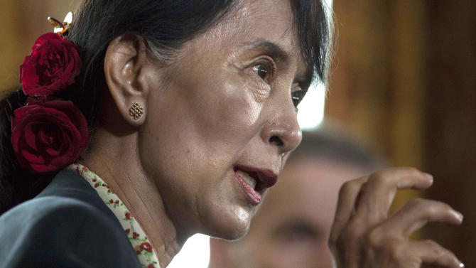 Myanmar's opposition leader Aung San Suu Kyi speaks during a news conference after attending a meeting of the Oslo Forum at the Losby Gods resort, about 13 kilometers (8 miles) east of Oslo, Monday, June 18, 2012. The Oslo Forum is an international network of armed conflict mediation practitioners. (AP Photo/Markus Schreiber)
