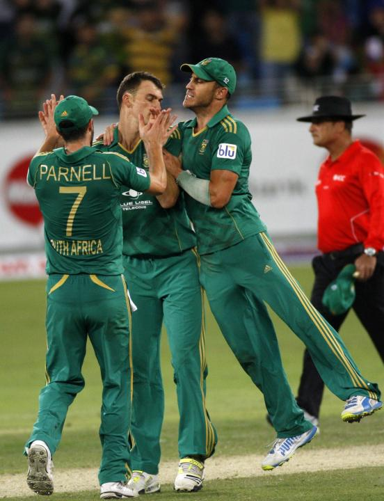 South Africa's Ryan Mclaren celebrates with his team mates the wicket of Pakistan's Umar Akmal during their second Twenty20 international cricket match in Dubai