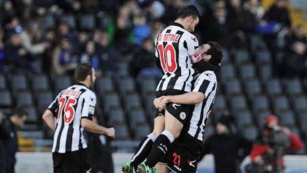 s Antonio Di Natale (C) celebrates with his teammate Andrea Lazzari after scoring a goal during the Italian Serie A football match between Udinese and Inter Milan on January 6, 2013 (AFP)