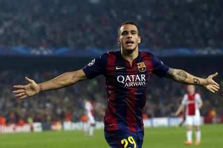 Barcelona's Sandro celebrates after scoring a goal against Ajax Amsterdam during their Champions League soccer match in Barcelona