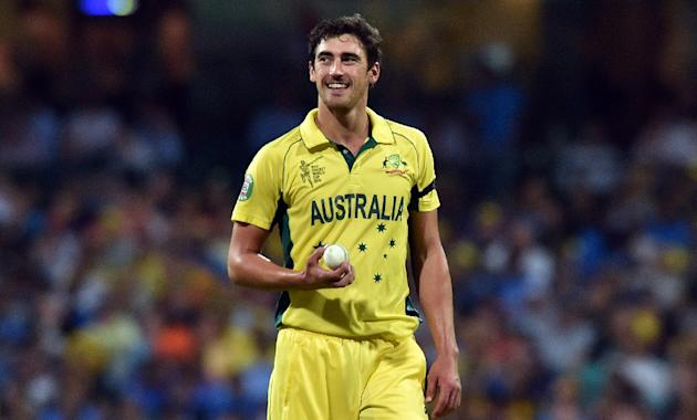 Australia's paceman Mitchell Starc walks towards his bowling mark during the semi-final against India at Sydney Cricket Ground on March 26, 2015
