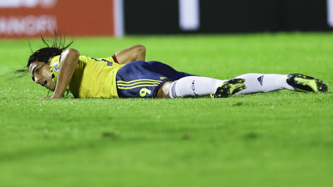 FILE - In this Sept. 10, 2013 file photo Colombia's Radamel Falcao Garcia looks up from the pitch during a 2014 World Cup qualifying soccer match against Uruguay in Montevideo, Uruguay. Falcao was injured this Wednesday, Jan. 22, 2014 during a French Cup game against Chasselay and is due to have further medical tests in the coming days to clarify the exact nature of the injury. (AP Photo/Natacha Pisarenko, File)