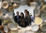People attend a private viewing of the ART Rio-International Art Fair in Rio de Janeiro, Brazil, Wednesday, Sept. 4, 2013. Over 100 galleries from more than a dozen countries are taking part in the five-day event, which opens on Thursday to the general public. (AP Photo/Silvia Izquierdo)