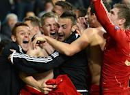 Bayern Munich's midfielder Bastian Schweinsteiger (2nd L) celebrates after scoring the winning penalty during the penalty shoot out at the end of the UEFA Champions League second leg semi-final football match Real Madrid against Bayern Munich at the Santiago Bernabeu stadium in Madrid. Bayern reached the final