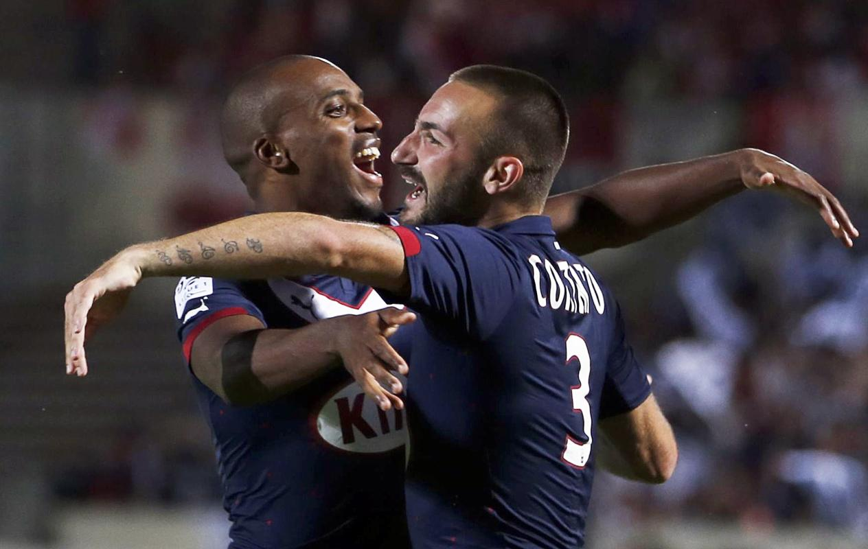 Diego Armando Valentin Contento of Girondins Bordeaux celebrates with his team mate Nicolas Maurice Belay during their French Ligue 1 soccer match...