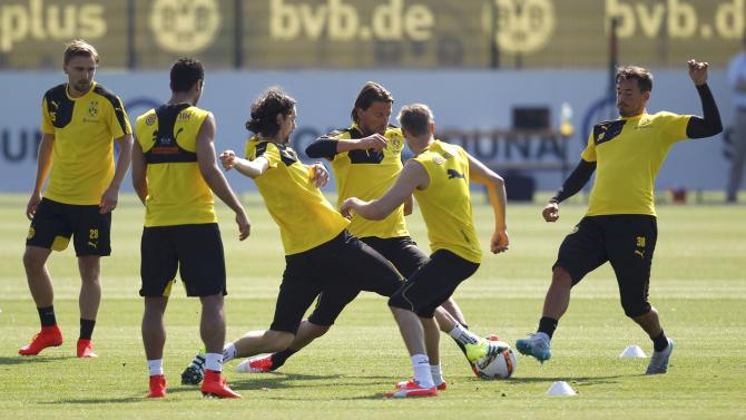 Borussia Dortmund's players warm-up during the first training session for the new soccer season in Dortmund