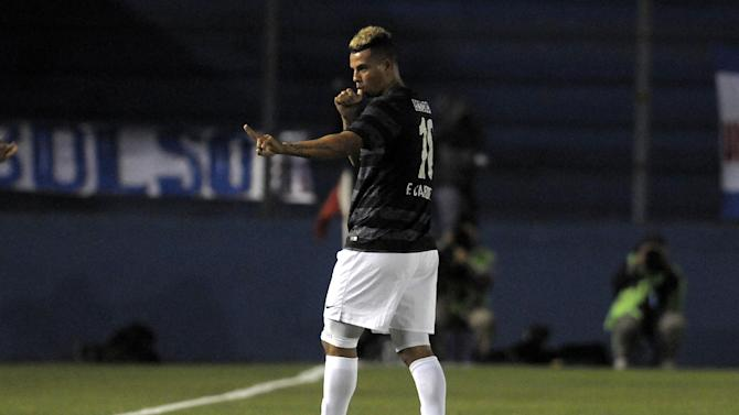 Edwin Cardona of Colombia's Atletico Nacional celebrates after scoring against Uruguay's Nacional during a Copa Libertadores soccer game in Montevideo, Uruguay, Tuesday, March 18, 2014. Atletico Nacional won the match 1-0