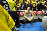 Jeric Teng sits dejected after the UST Tigers lost to Ateneo in Game 2 of the UAAP Finals. (NPPA Images)