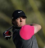 Northern Ireland's Rory McIlroy plays a shot during the first round of the Abu Dhabi Golf Championship at the Abu Dhabi Golf Club in the Emirati capital on January 17, 2013. Justin Rose grabbed a share of the first round lead in the Abu Dhabi Golf Championship on a day when both McIlroy and Tiger Woods struggled to get their seasons into gear