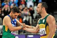 South Africa's Oscar Pistorius (R) shakes hands with Brazil's Alan Oliveira after losing to him in the Men's 200m T44 final at the London 2012 Paralympic Games on September 2. Pistorius has apologised for the timing of his outburst after the loss, in which he claimed it was not a fair race, but insisted there was an issue with large prosthetics lengthening an amputee's stride