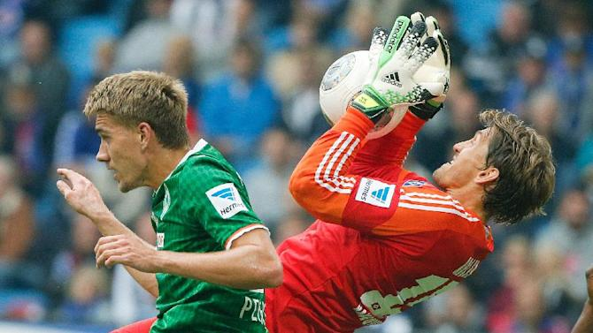 Bremen's Nils Petersen , left, and Hamburg 's goalie  Rene Adler challenge for the ball during the German Bundesliga soccer match between SV Hamburg and SV Werder Bremen in Hamburg, northern Germany Saturday Sept. 21  2013