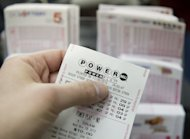 A Powerball lottery ticket is seen in a convenience store in Washington in November 2012. A lucky player in Arizona has claimed the second winning ticket in the US Powerball lottery's near-record jackpot of $587.5 million, organizers said