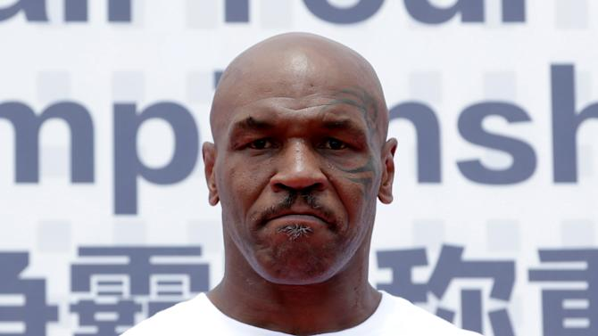 Former boxer Mike Tyson attends the weigh-in of IBF World Championship Bout on the outskirts of Beijing