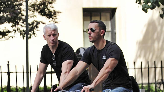 Anderson Cooper and boyfriend Ben Maisani take a cycle in New York's West Village