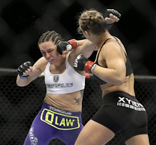 Ronda Rousey (right) beat Alexis Davis in 16 seconds at UFC 175. (AP)