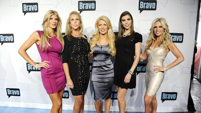 "FILE - In this April 4, 2012 file photo, cast members for ""The Real Housewives of Orange County,"" from left, Alexis Bellino, Vicki Gunvalson, Gretchen Rossi, Heather Dubrow and Tamra Barney, attend the Bravo network 2012 upfront presentation in New York.  Later in 2013, ""The Real Housewives of Orange County"" will reach a TV milestone: its 100th episode. To mark the occasion, Bravo is planning a standalone two-hour special that will pull back the curtain on the series and revisit past cast members.(AP Photo/Evan Agostini, File)"